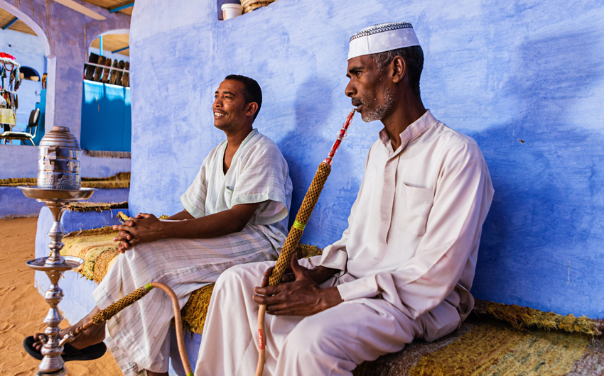 Nubian men smoking waterpipe