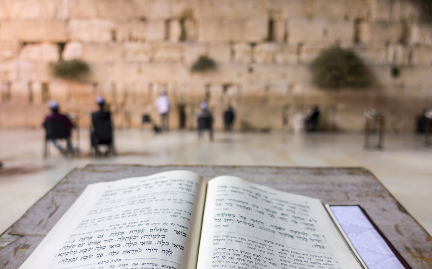 Prayer book in front of Western Wall, Jerusalem
