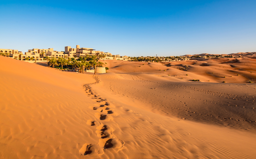 Footprints on desert sand in Abu Dhabi