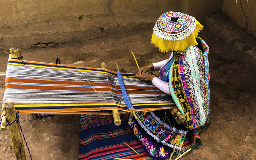 Inca woman weaving alpaca wool, Peru