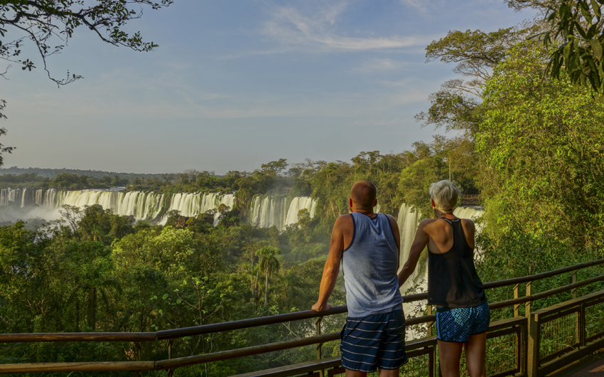 Tourists near the Iguazu Falls, waterfalls of the Iguazu River on the border of the Argentina and the Brazil