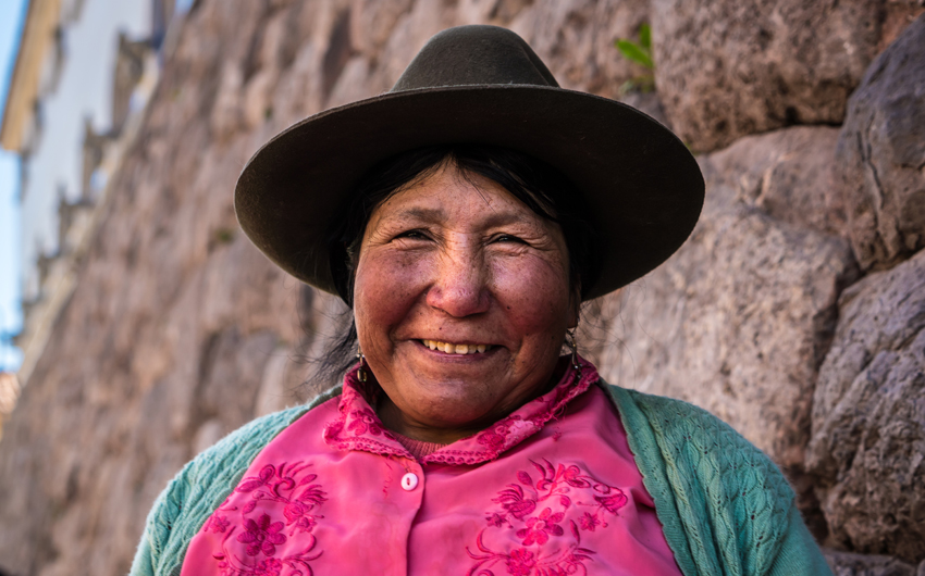 Peruvian woman at Inca ruins
