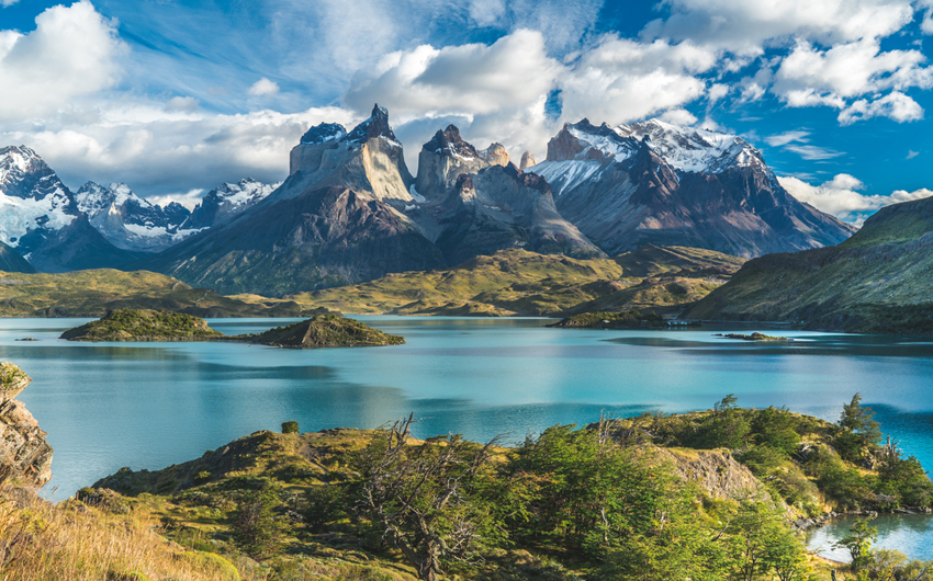 Blue Lake on a Snowy Mountains Background and Cloudy Sky, Torres del paine