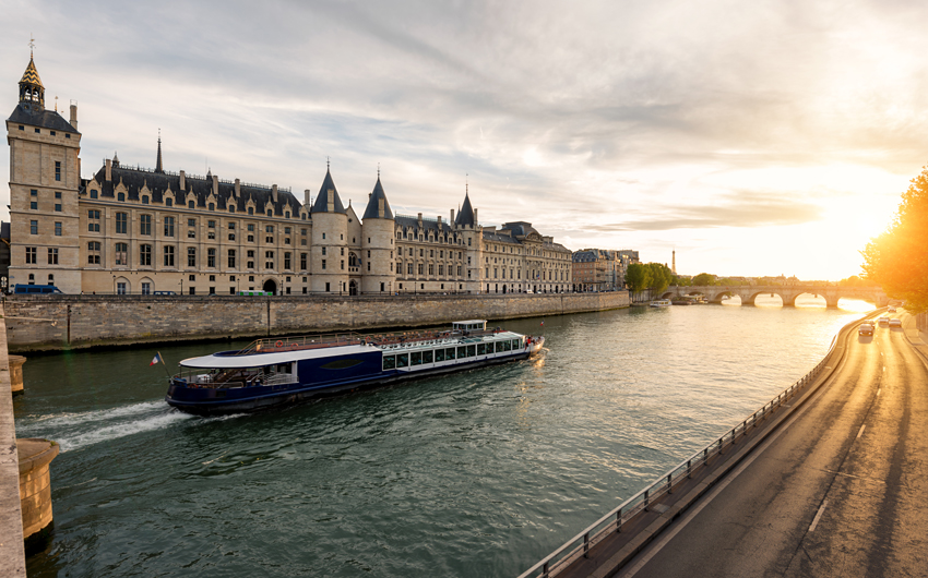 Boat tour on Seine river in Paris with sunset