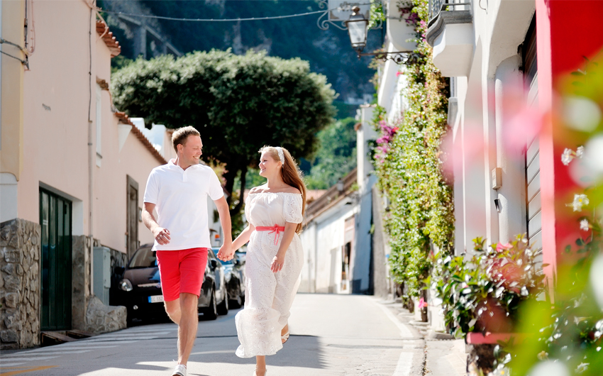Couple walking through Positano