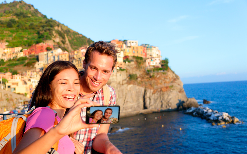 Couple taking picture in Cinque Terre