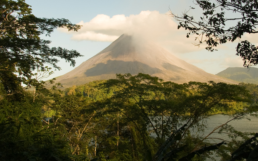 Arenal Volcano through the trees and over Lake Arenal