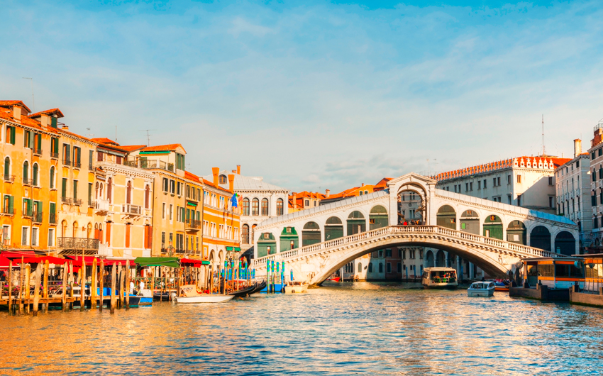 Rialto Bridge with Gondola under the bridge in Venice