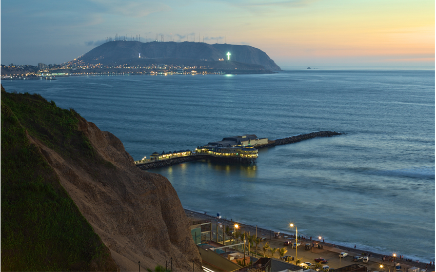 The coastline of Lima, Peru at twilight with the Restaurant La Rosa Nautica