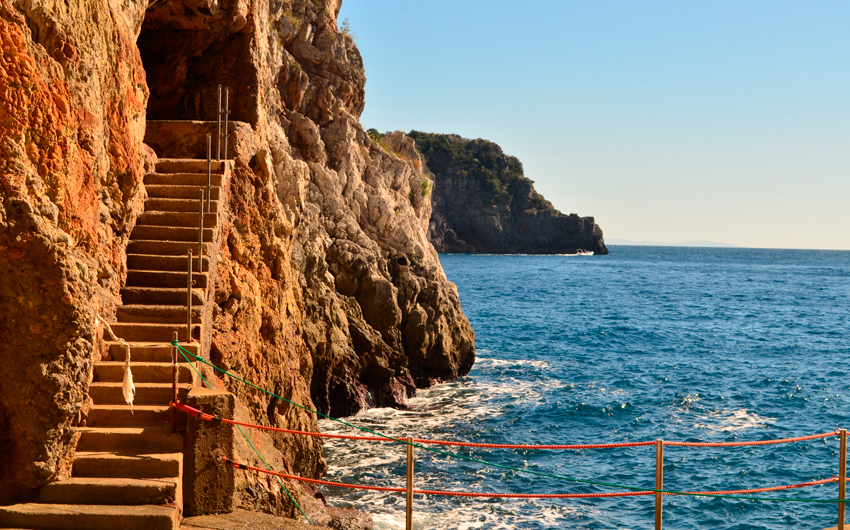 Stone stairs cut into the sea cliff along the Amalfi Coast