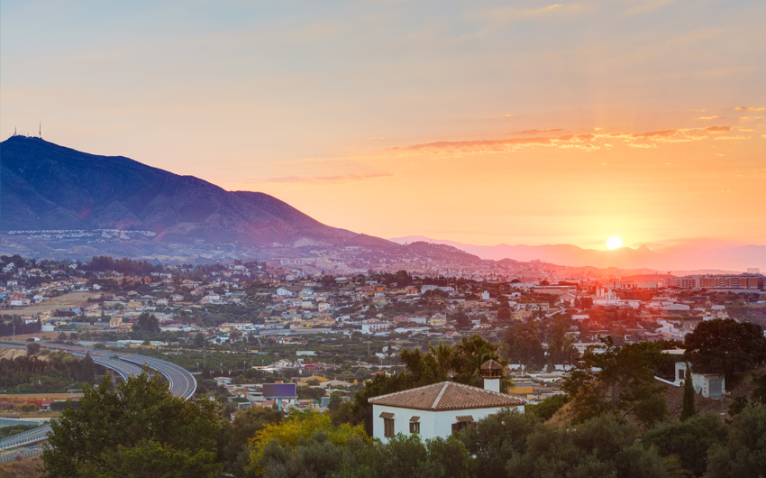Sunset Over Mountains and town Mijas