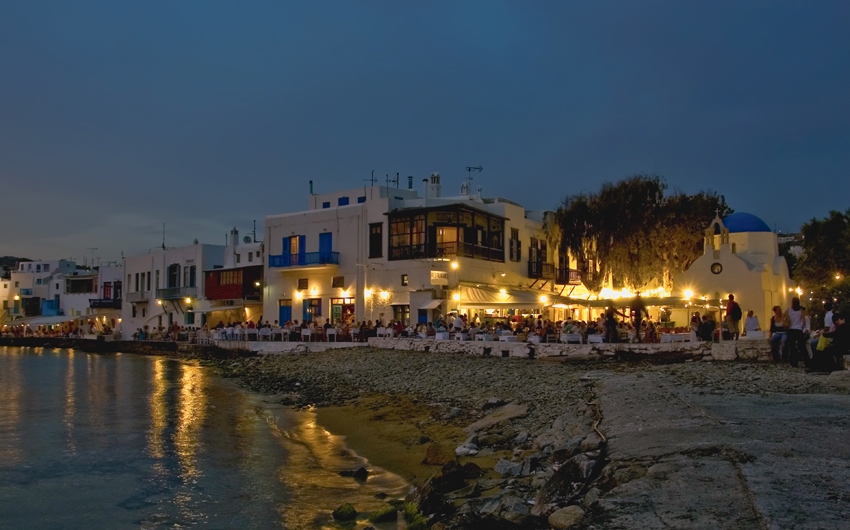 People at restaurants on the beautiful beach of Mykonos