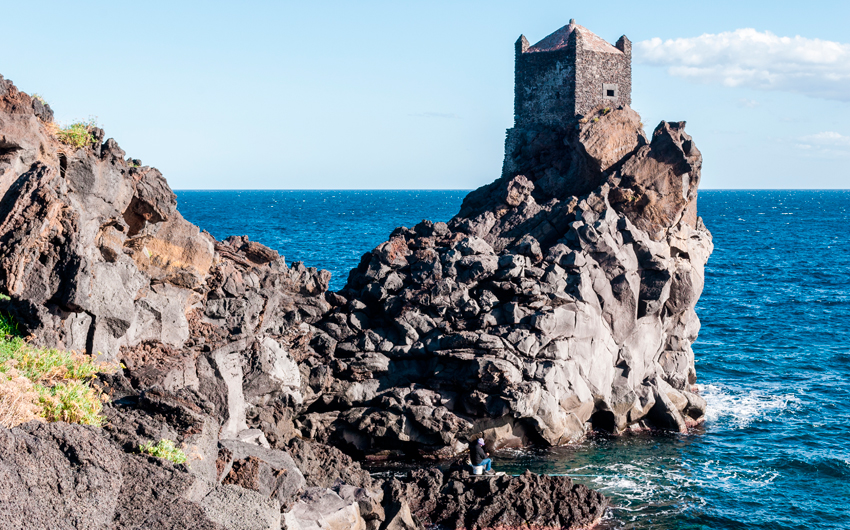 Watchtower on a lava cliff near Acireale
