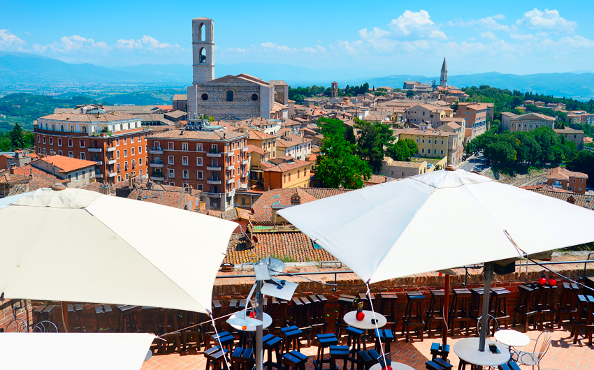 perugia italy restaurant town old skyline landmark view church europe center building horizontal ancient medieval umbria exterior clear sunny street italian tourist nobody outdoor tile destination landscape empty heritage sun mountain bright culture sk