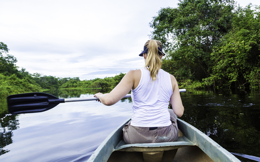 Riding a canoe in Pantanal River