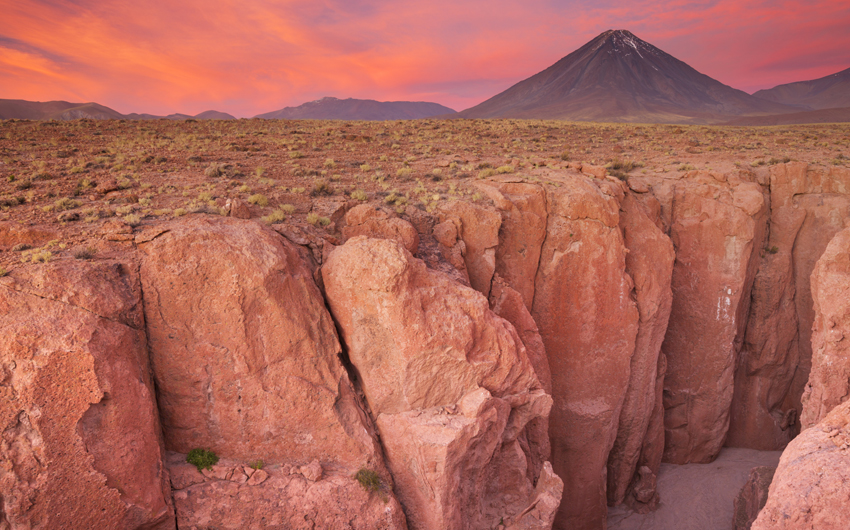 Narrow canyon and Volcan Licancabur, Atacama Desert