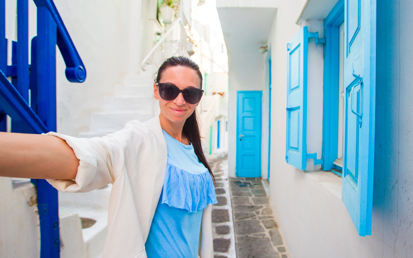 Woman on vacation exploring Santorini