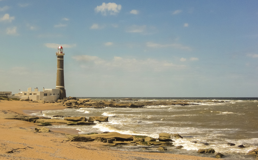 Beautiful summer day at the beach with the lighthouse as the main subject in Jose Ignacio
